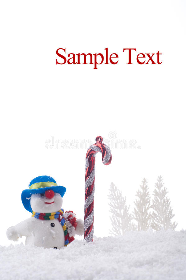 Snowman with christmas cane royalty free stock image