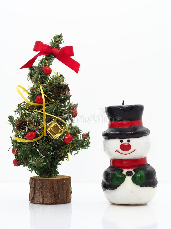 Christmas composition,snowman and christmas tree stock images