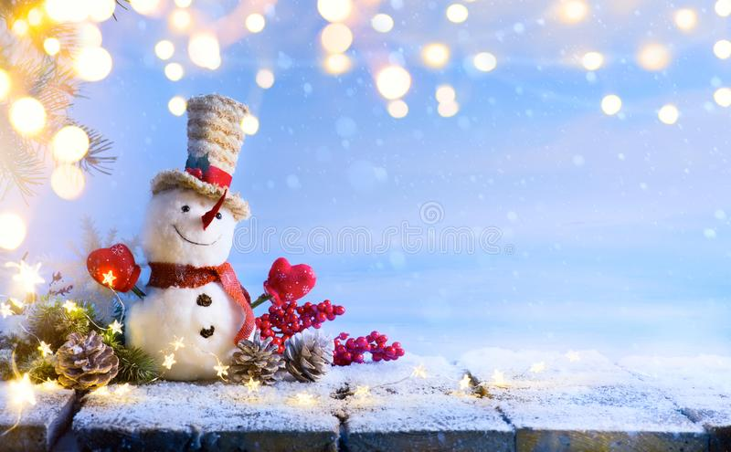 Snowman and Christmas tree decoration; background or season holidays banner. Art Snowman and Christmas tree decoration; background or season holidays banner stock photos