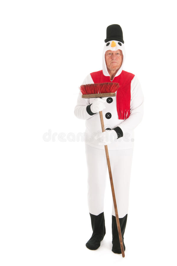 Snowman cleaning the street. Human snowman is cleaning the street with broom royalty free stock photos