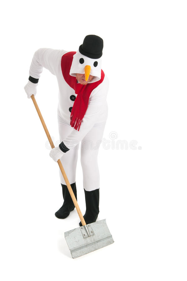 Snowman cleaning the street. Human snowman is cleaning the street from snow royalty free stock photography