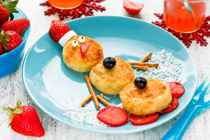 Snowman cottage cheese pancakes for breakfast. Christmas fun food for kids royalty free stock image