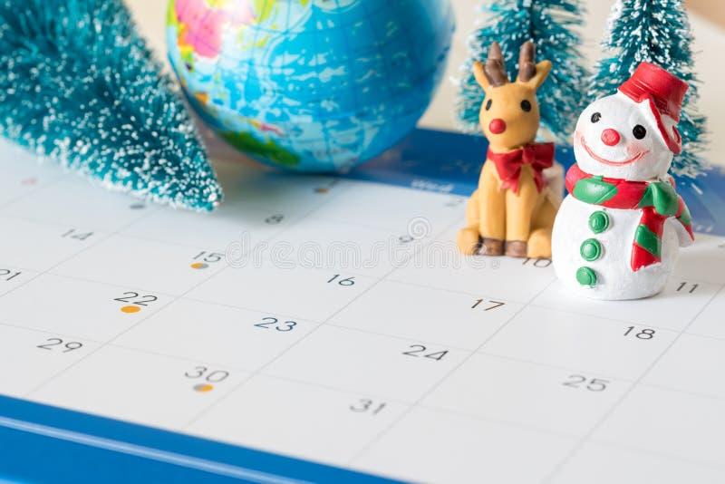 Snowman and 31 day calendar , christmas ornamental background stock photo