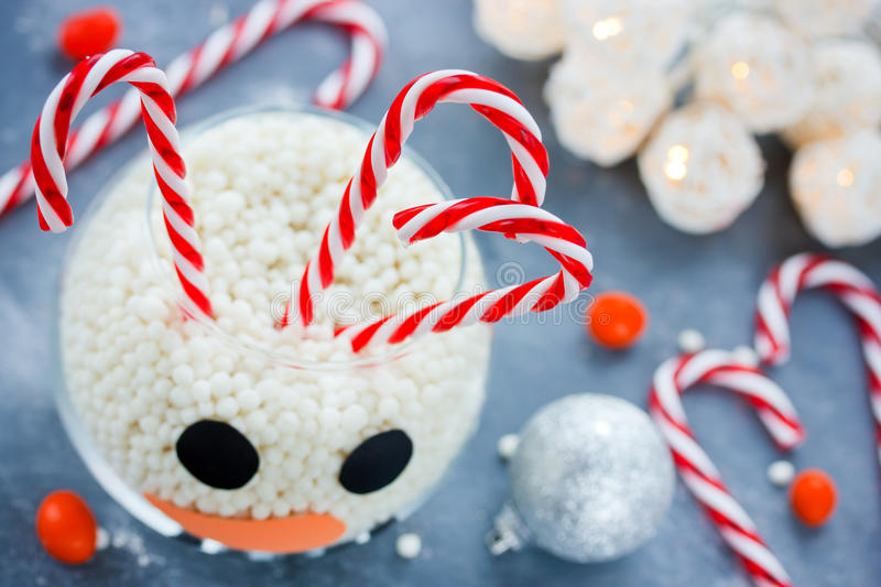 Snowman face glass bowl, kid diy for Christmas, sweet treats for. Children, Happy New Year and Merry Christmas concept background royalty free stock photography