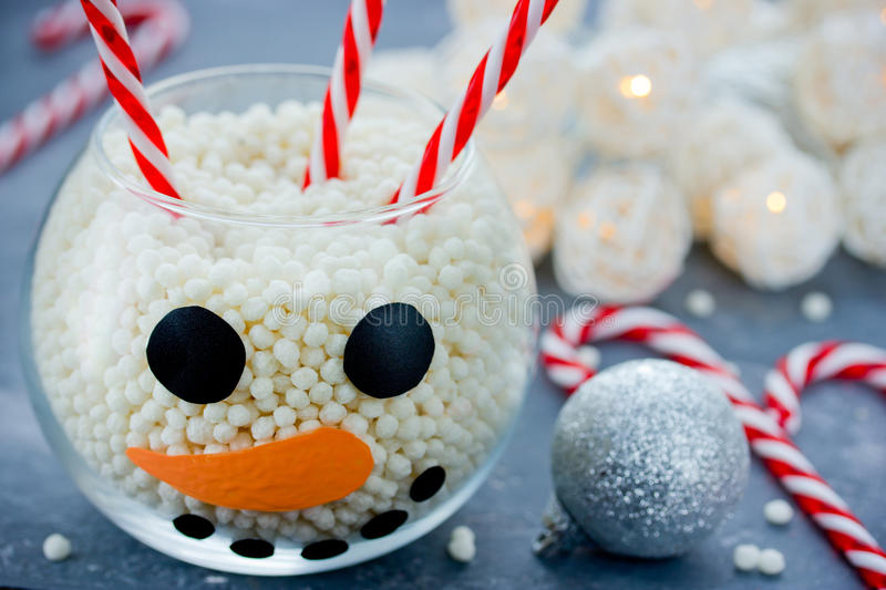 Snowman face glass bowl, kid diy for Christmas, sweet treats for. Children, Happy New Year and Merry Christmas concept background royalty free stock photo