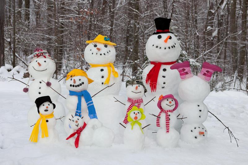 Snowman family. Happy and cute snowmen outdoors