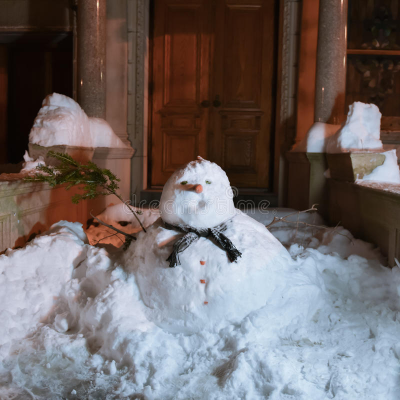 Snowman in front of doorway royalty free stock images