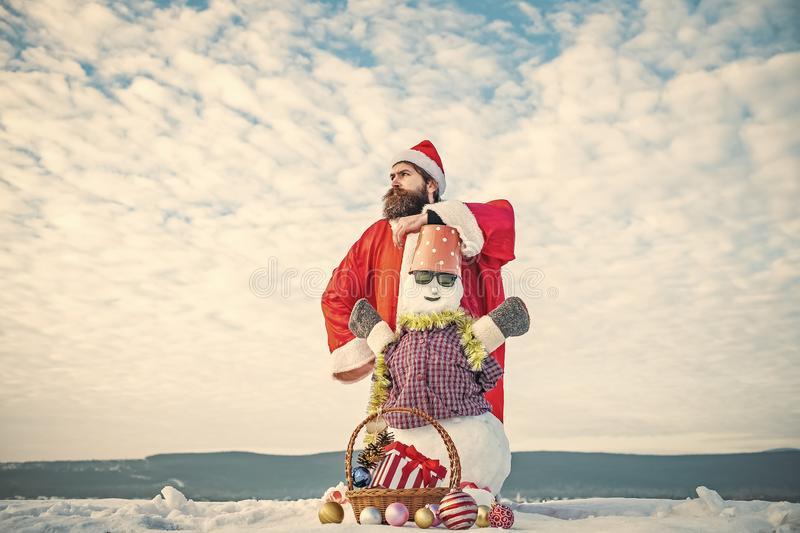 Snowman in glasses and bucket on head royalty free stock images