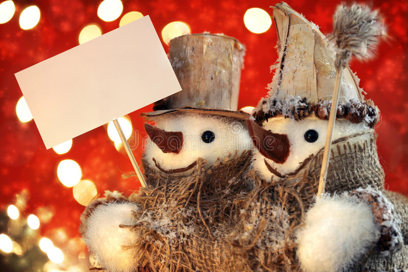 Snowman Holding Blank Sign Stock Images