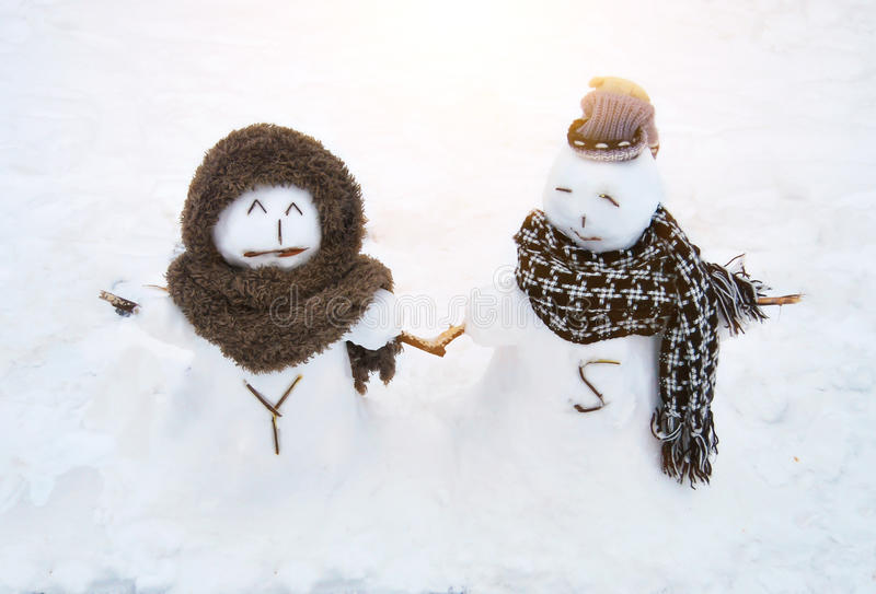 Snowman love. Two snowman hand to hand shows the true love royalty free stock photography
