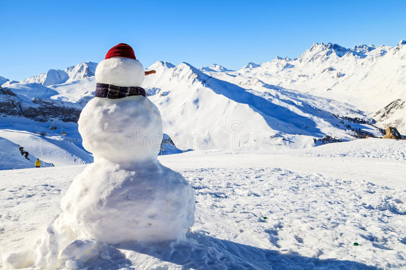 Snowman in mountains stock photography