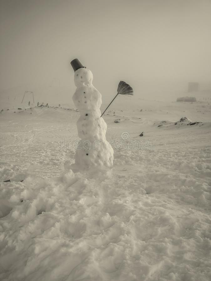 Snowman In The Mountains royalty free stock image