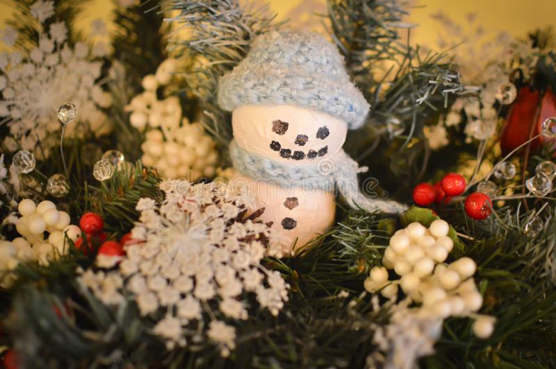 Snowman Ornament with Blue Knit Hat and Scarf stock photos