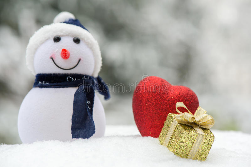 Download Snowman outdoor stock photo. Image of winter, heart, snowman - 28129856