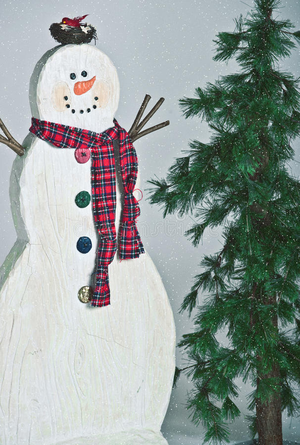 Snowman and Pine Tree stock image