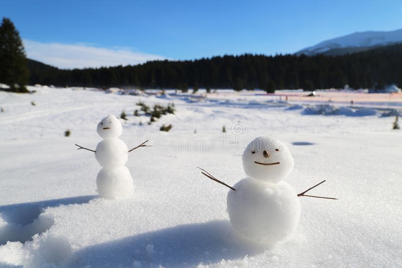 Snowman play winter game royalty free stock images