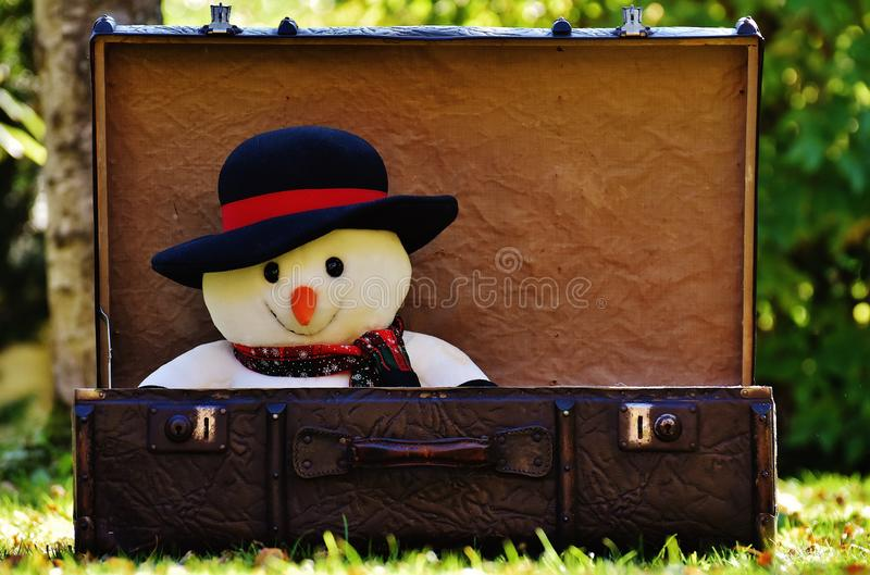 Snowman plush toy in suitcase royalty free stock image
