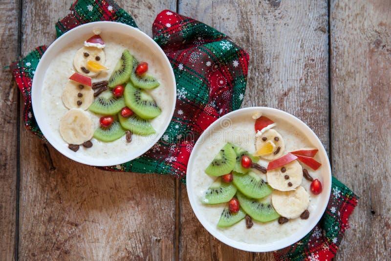 Snowman porridge oatmeal breakfast , Fun Christmas for kids. Snowman porridge oatmeal breakfast , Fun Christmas food art for kids royalty free stock photo