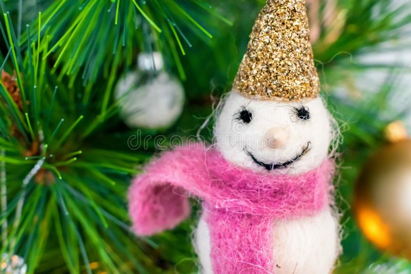 Snowman with purple scarf Christmas tree decoration royalty free stock images