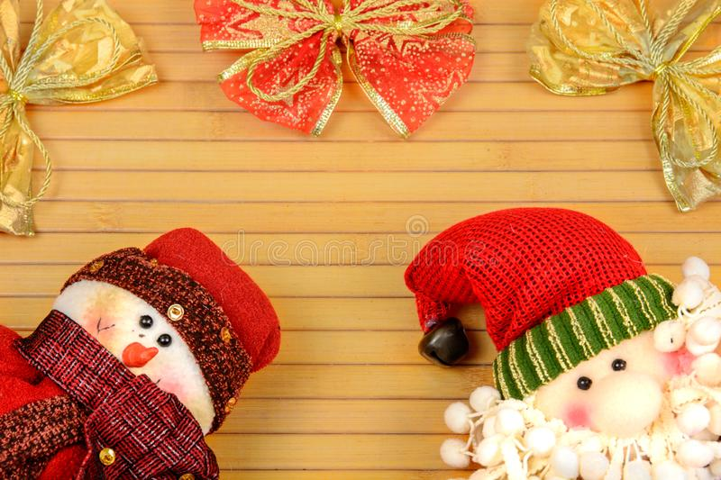 Snowman and Santa on a wooden background royalty free stock photo