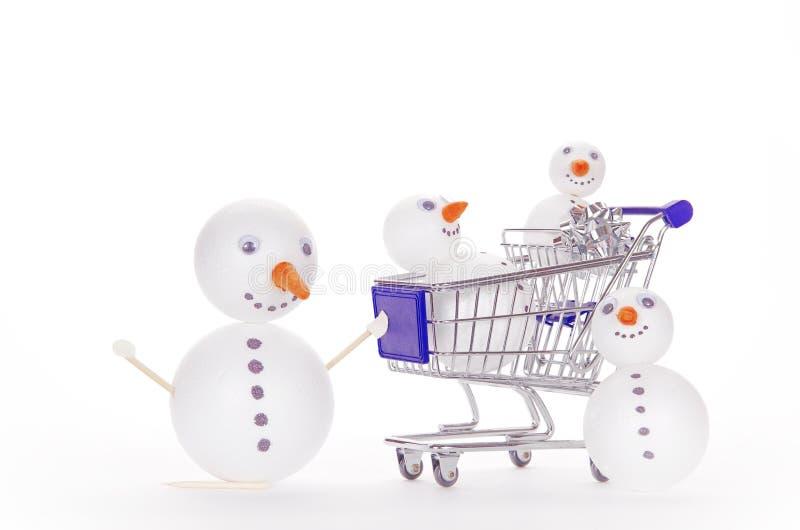 Snowman shopping cart stock photography