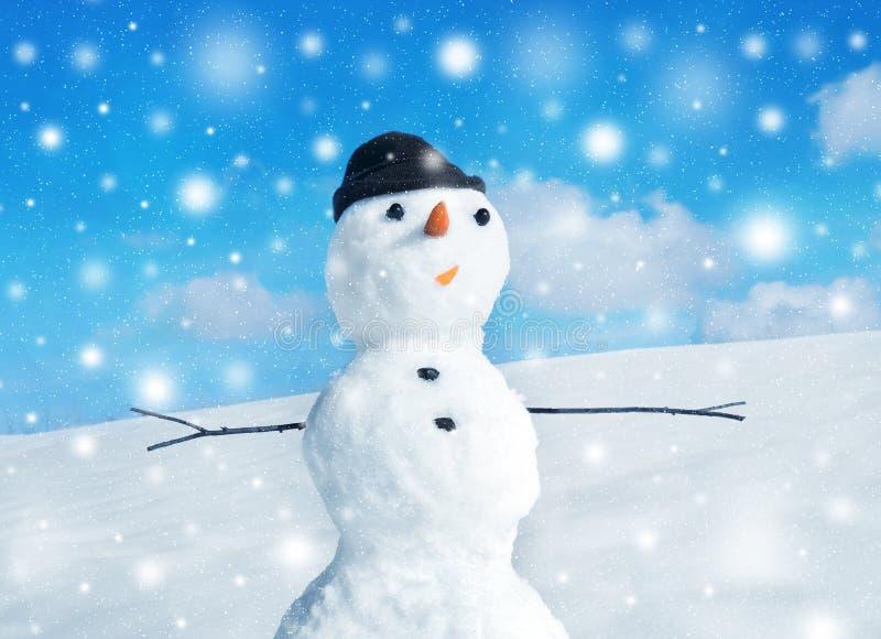Snowman and snowstorm stock photos