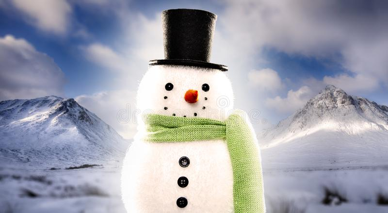 Snowman on snowy mountain background royalty free stock images