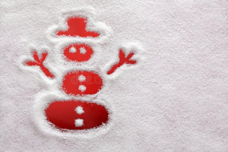 Snowman som tecknas i snowen royaltyfri foto