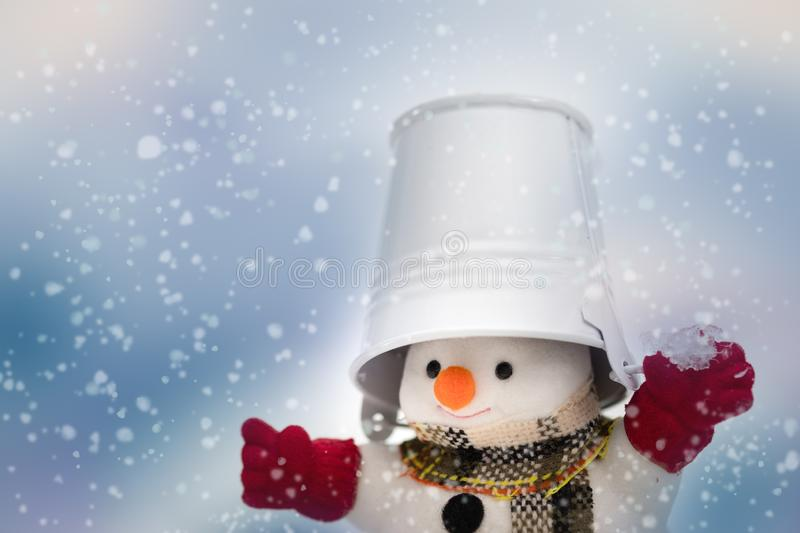 Snowman is standing in snowfall, Merry Christmas and happy New Y. Ear concept royalty free stock photography