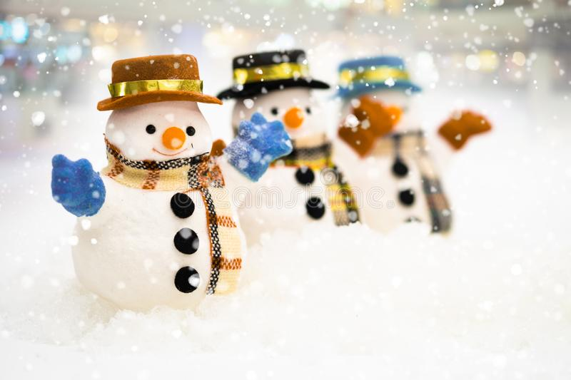 Snowman is standing in snowfall, Merry Christmas and happy New Year concept.  stock images