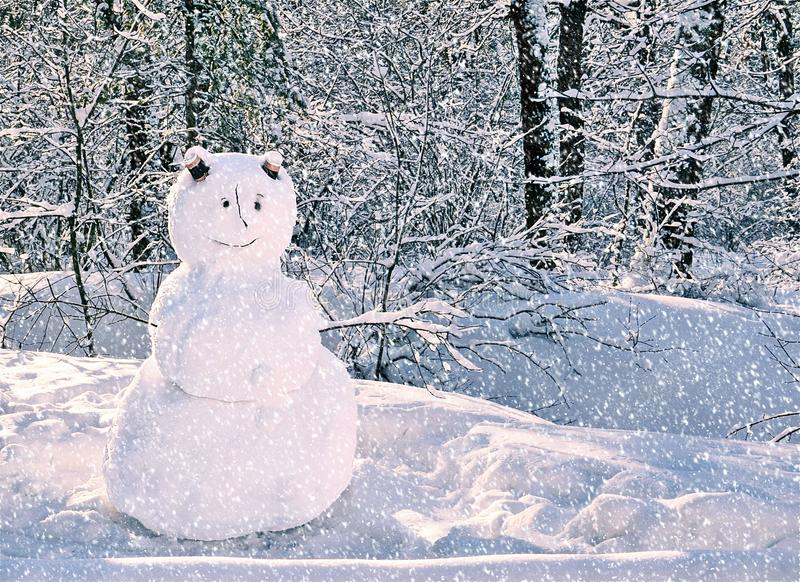 Snowman standing in snowy winter forest. Merry Christmas and Happy New Year greeting card with copy space. royalty free stock photography