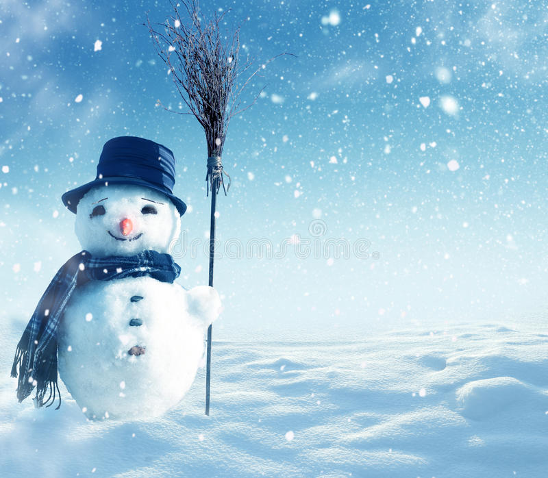 Snowman standing in winter christmas landscape stock image