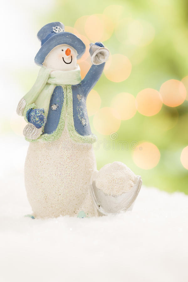Free Snowman Statue On Snow Over A Blurry Abstract Background Stock Image - 27858901