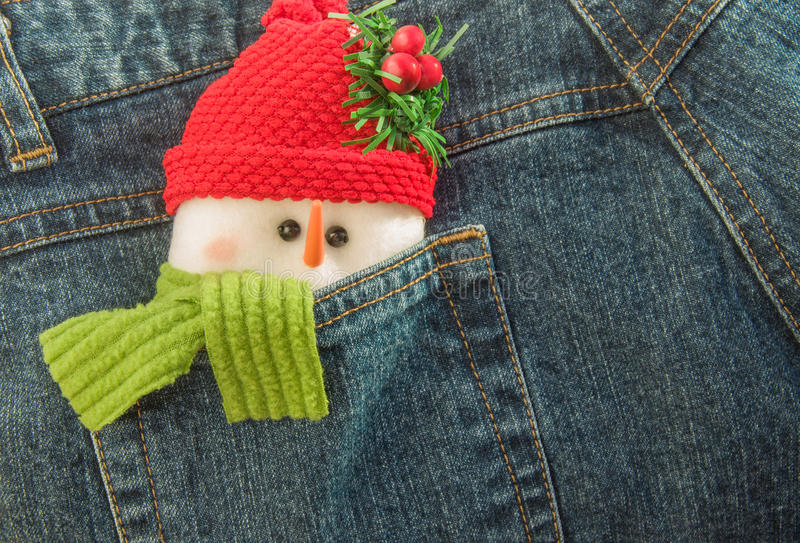 Snowman tucked into back pocket of jeans. stock image