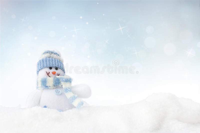 Snowman on the winter background royalty free stock photos