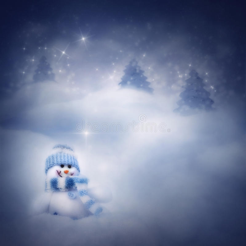 Snowman on the winter background stock photos
