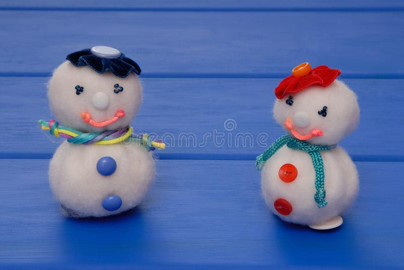 Snowmans on New Year`s post card, snowmans on Christmas card, h royalty free stock photos
