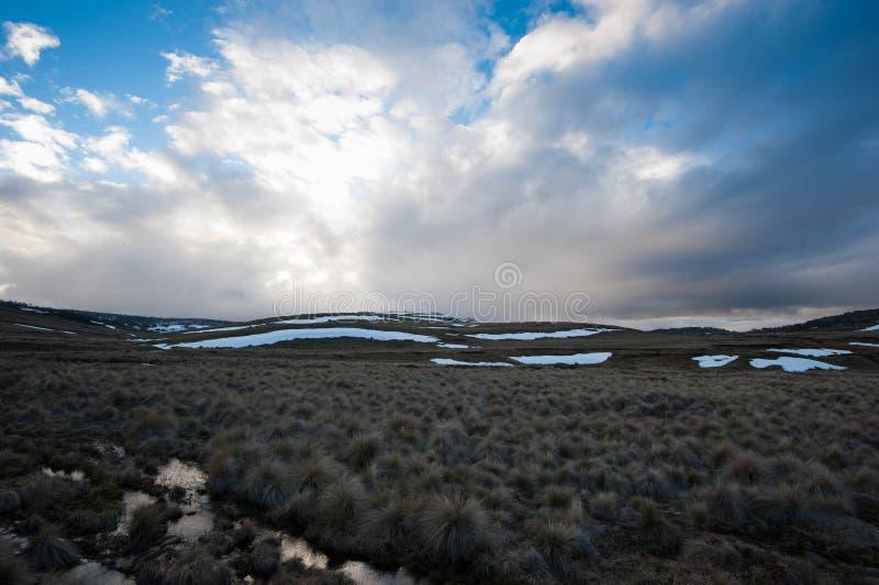 Snowmelt alpin images stock