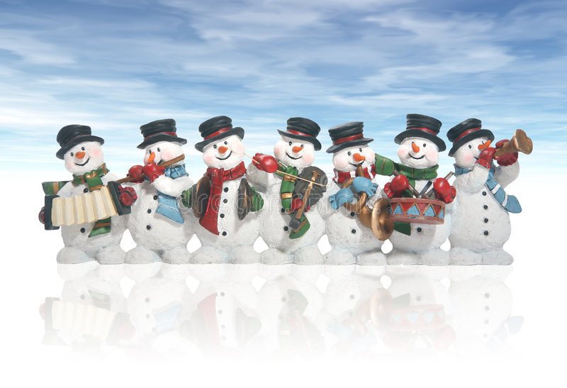 Snowmen. Playing music instruments isolated over white