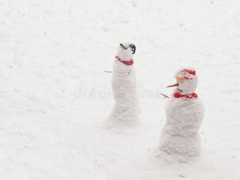 Download Snowmen stock photo. Image of smiling, figure, scene - 23128566