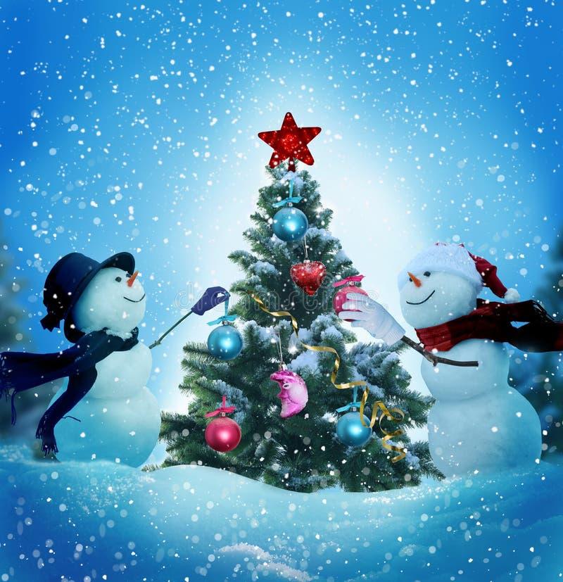 Decorate Christmas Tree Like Snowman: Snowmen Decorating A Christmas Tree Stock Photo