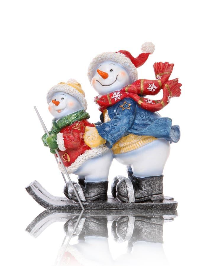Snowmen Skiing stock images