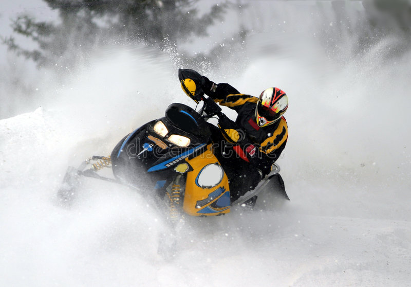 Snowmobile action shot stock photography
