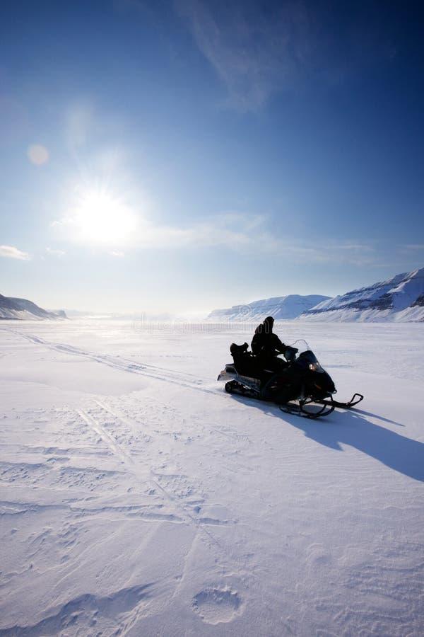 snowmobile de silhouette image stock