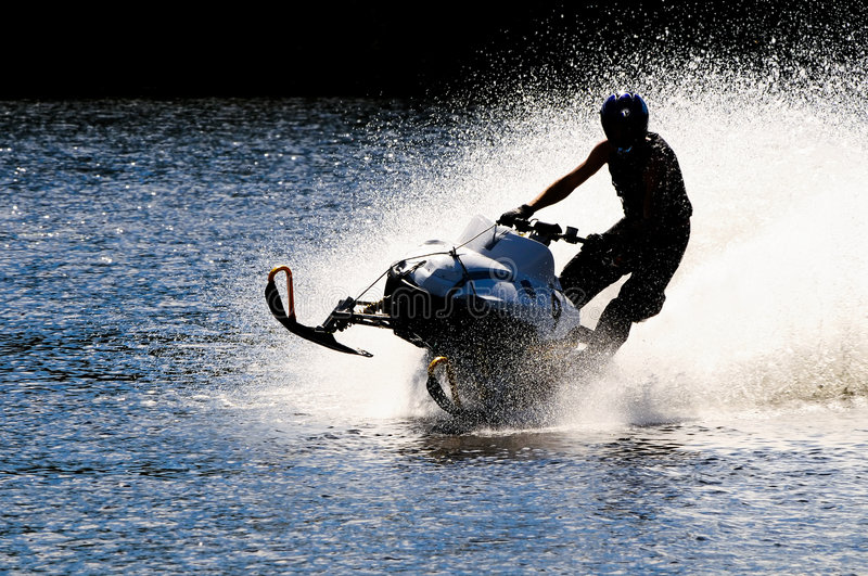 Snowmobile on open water royalty free stock images