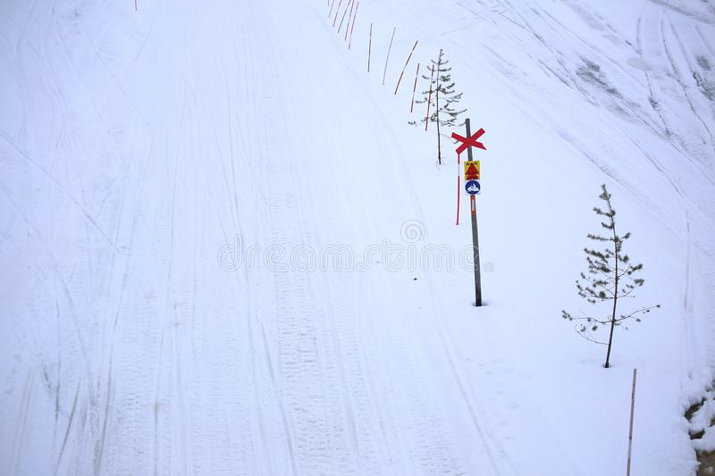 Snowmobile path in Lycksele, northern Sweden. The sign says - do not depart from path.  stock image