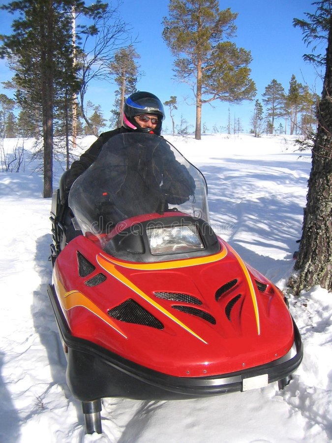 Snowmobile riding royalty free stock photo