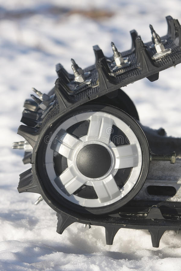 Download Snowmobile Track Against Snow Stock Photography - Image: 18479172