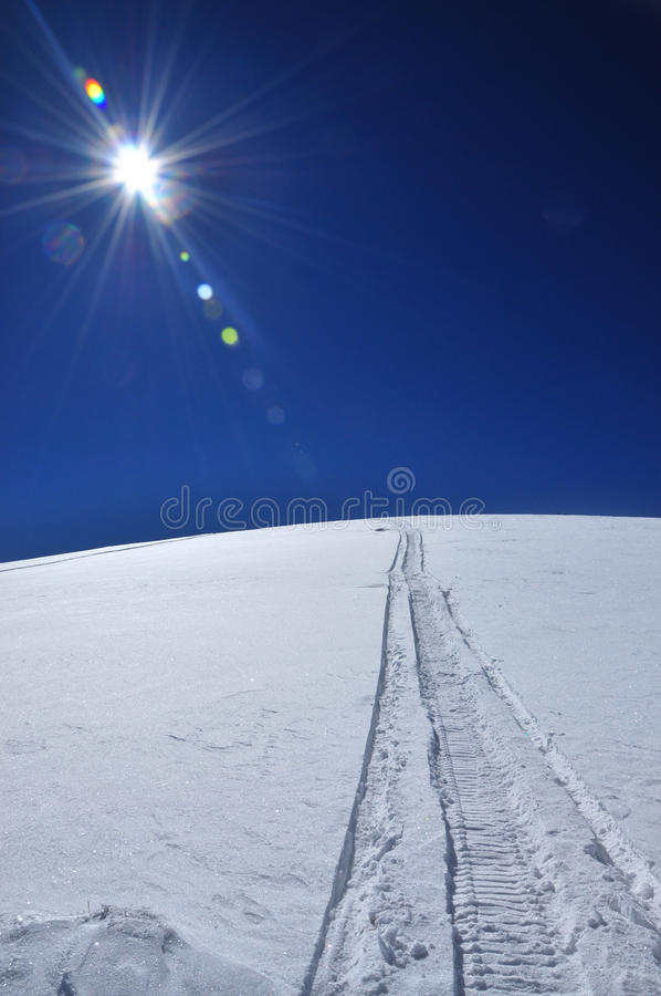 Download Snowmobile Tracks In The Snow Stock Photography - Image: 18798512