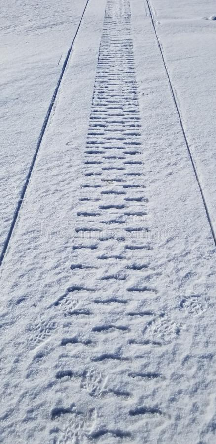 Snowmobile tracks in the snow stock photo
